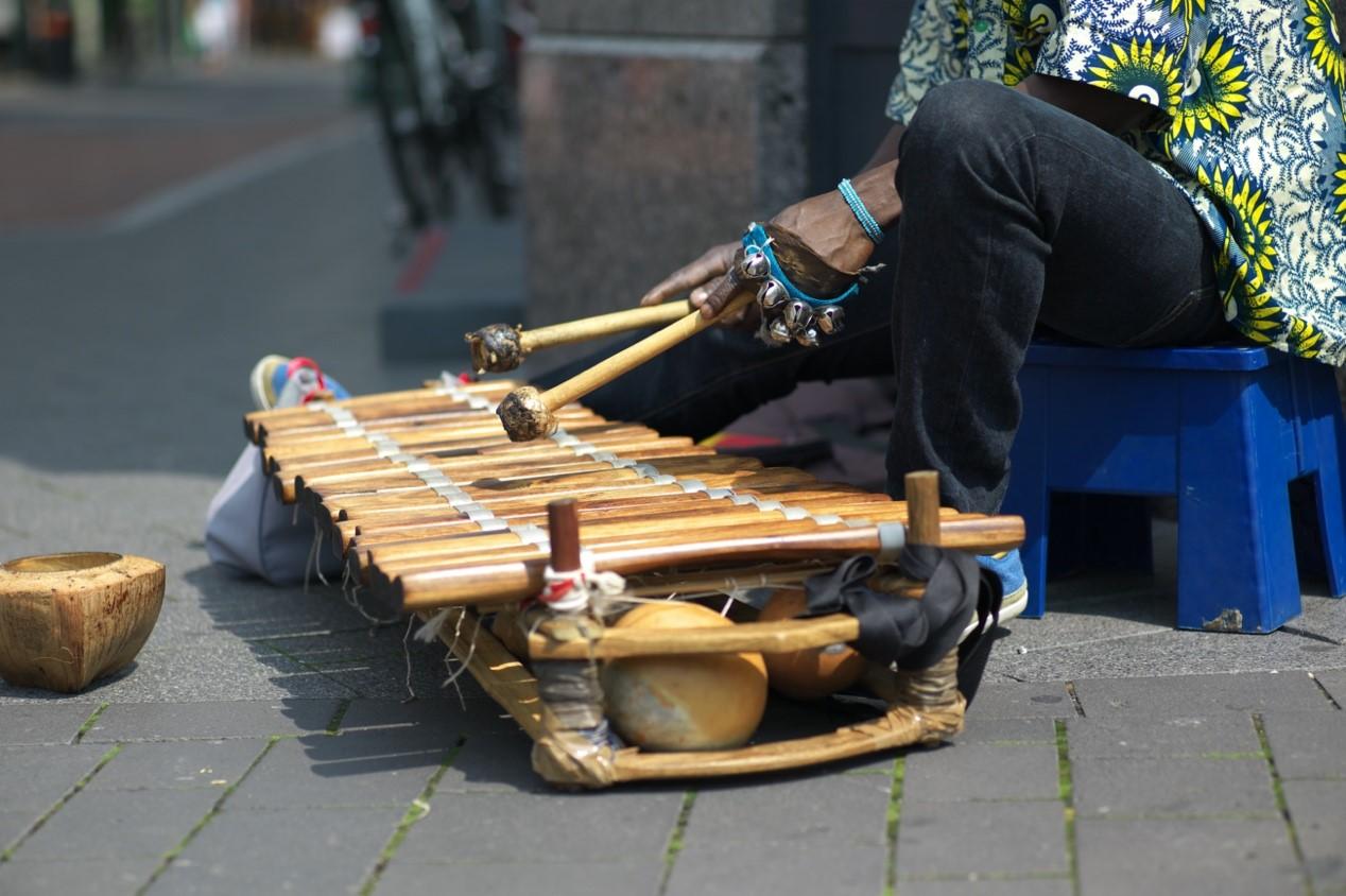 Man playing the balafon, an African musical instrument