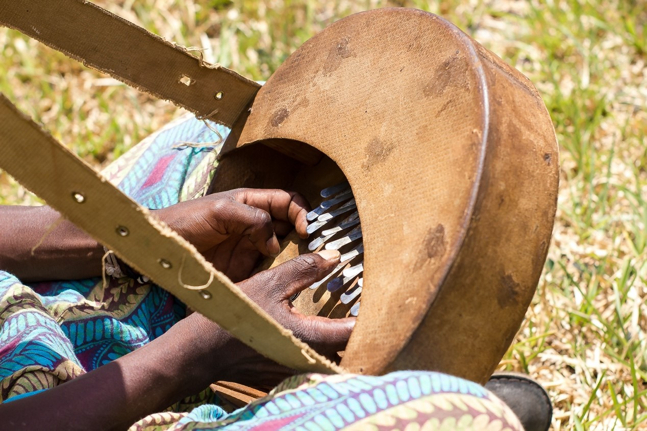 Man playing mbira, an African musical instrument